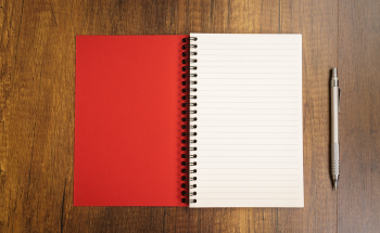 Red notebook on a table