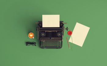 Typewriter on green background